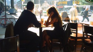 man-and-woman-in-coffee-shop-looking-through-window